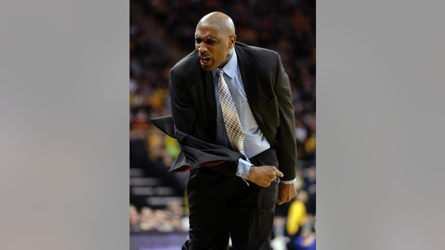 Longwood head coach Jayson Gee reacts to a call against his team during the first half of their NCAA college basketball game against Iowa on Saturday, Nov. 29, 2014, in Iowa City, Iowa. (AP Photo/Jim Slosiarek)
