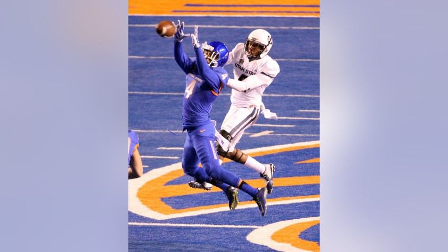 Boise State safety Darian Thompson makes an interception during the first half of an NCAA college football game, Saturday, Nov. 29, 2014 in Boise, Idaho. (AP Photo/The Idaho Statesman, Darin Oswald)  LOCAL TELEVISION OUT (KTVB 7); MANDATORY CREDIT
