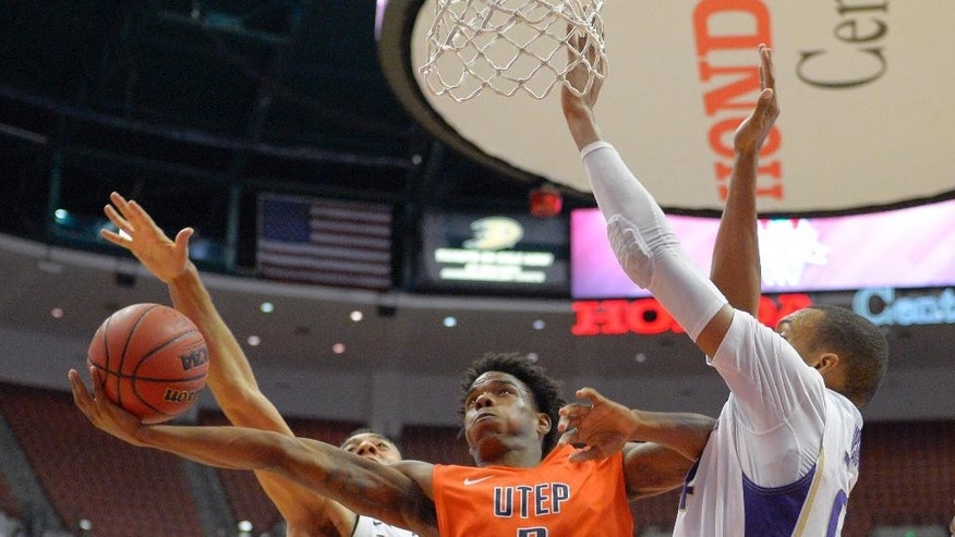 UTEP guard Omega Harris, center, puts up a shot a Washington guard Nigel Williams-Goss, left, and center Robert Upshaw defend during the second half an NCAA college basketball game at the the Wooden Legacy tournament, Sunday, Nov. 30, 2014, in Anaheim, Calif. Washington won 68-65. (AP Photo/Mark J. Terrill)