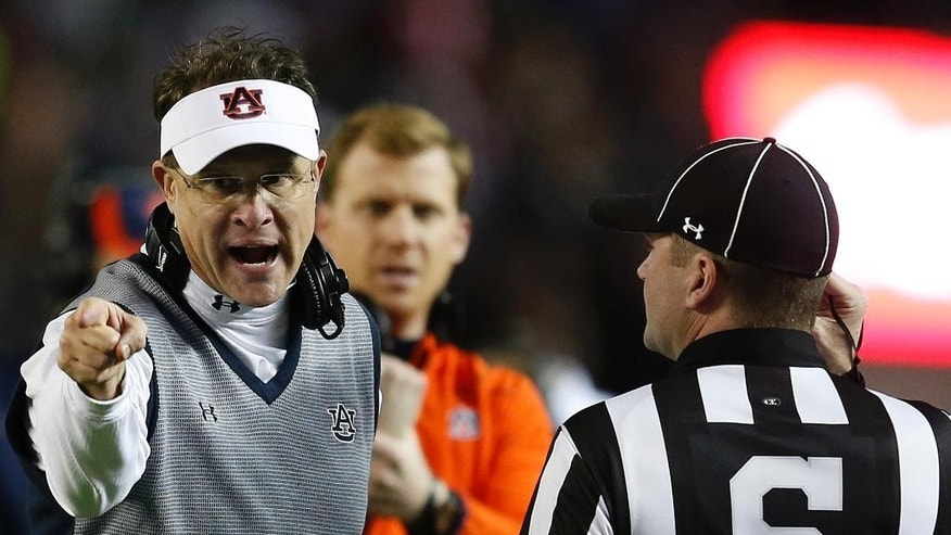Auburn head coach Gus Malzahn speaks to official during the second half of the Iron Bowl NCAA college football game against Alabama, Saturday, Nov. 29, 2014, in Tuscaloosa, Ala. Alabama won 55-44. (AP Photo/Butch Dill)