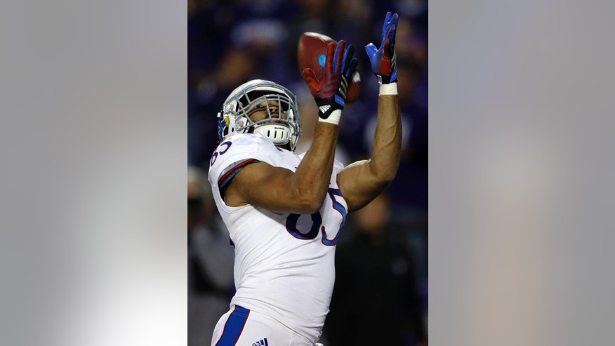 Kansas tight end Trent Smiley catches a touchdown pass during the second half of an NCAA college football game against Kansas State in Manhattan, Kan., Saturday, Nov. 29, 2014. Kansas State won 51-13. (AP Photo/Orlin Wagner)