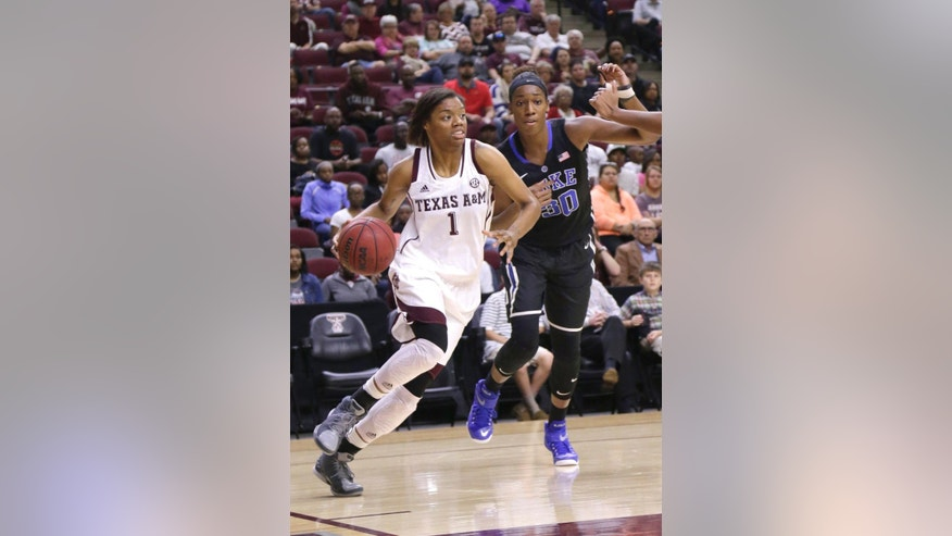 Texas A&M's Courtney Williams (1) drives the ball past Duke's Amber Henson (30) during the first half of an NCAA college basketball game Sunday, Nov. 30, 2014, in College Station, Texas. (AP Photo/Pat Sullivan)