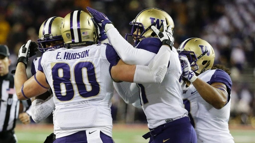Washington's Evan Hudson (80) celebrates with teammates after he caught a pass in the second half of an NCAA college football game against Washington State, Saturday, Nov. 29, 2014, in Pullman, Wash. (AP Photo/Ted S. Warren)
