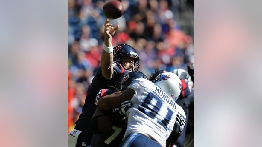 Tennessee Titans outside linebacker Derrick Morgan (91) is blocked as Houston Texans quarterback Ryan Fitzpatrick passes during the first half of an NFL football game against the Tennessee Titans Sunday, Nov. 30, 2014, in Houston. (AP Photo/Eric Gay)