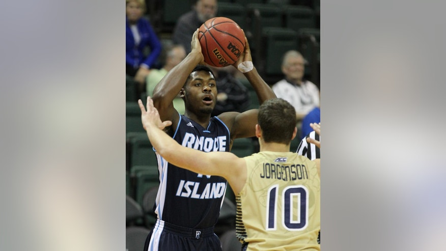 Rhode Island guard Biggie Minnis tries to pass against Georgia Tech guard Travis Jorgenson (10) during the first half of an NCAA college basketball game in Lake Buena Vista, Fla., Sunday, Nov. 30, 2014. (AP Photo/Reinhold Matay)