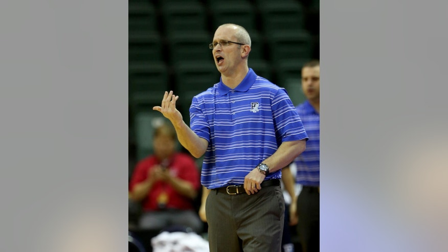 Rhode Island head coach Don Hurley watches the action during the first half of an NCAA college basketball game against Georgia Tech in Lake Buena Vista, Fla., Sunday, Nov. 30, 2014. (AP Photo/Reinhold Matay)