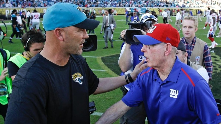 Jacksonville Jaguars head coach Gus Bradley, left, and New York Giants head coach Tom Coughlin shake hands after an NFL football game in Jacksonville, Fla., Sunday, Nov. 30, 2014. Jacksonville won 25-24. (AP Photo/John Raoux)