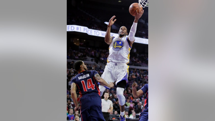 Golden State Warriors' Andre Iguodala (9) goes to the basket against Detroit Pistons' D.J. Augustin (14) during the first half of an NBA basketball game Sunday, Nov. 30, 2014, in Auburn Hills, Mich. (AP Photo/Duane Burleson)