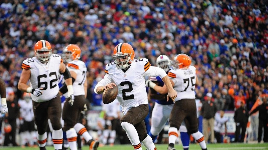 Cleveland Browns quarterback Johnny Manziel runs in for a score against the Buffalo Bills during the second half of an NFL football game, Sunday, Nov. 30, 2014, in Orchard Park, N.Y. (AP Photo/Gary Wiepert)