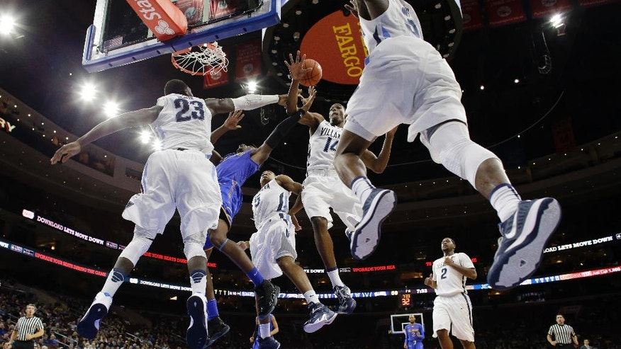 Delaware's Kory Holden, second from left, tries to get a shot past Villanova's Daniel Ochefu (23), Phil Booth (5), Darryl Reynolds (14) and Dylan Ennis (31) as Kris Jenkins (2) looks on during the second half of an NCAA college basketball game, Sunday, Nov. 30, 2014, in Philadelphia. Villanova won 78-47. (AP Photo/Matt Slocum)