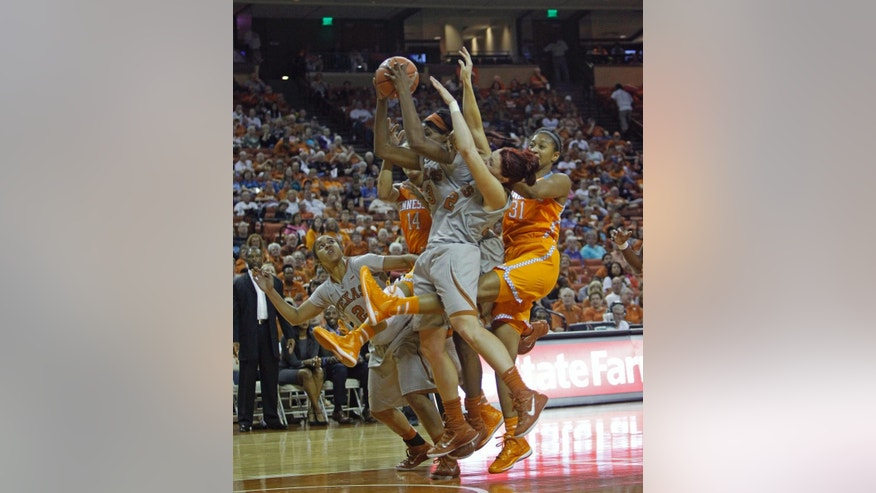 Texas guard Nneka Enemkpali (3) comes down with the ball during the first half of an NCAA college basketball game against Tennessee, Sunday, Nov. 30, 2014, in Austin, Texas. (AP Photo/Michael Thomas)