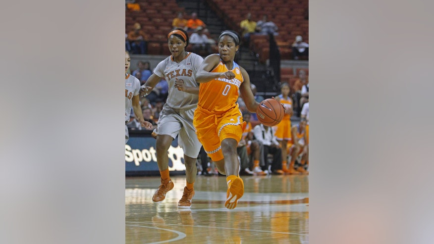 Tennessee guard Jordan Reynolds (0) dribbles against Texas guard Nneka Enemkpali during the first half of an NCAA college basketball game, Sunday, Nov. 30, 2014, in Austin, Texas. (AP Photo/Michael Thomas)