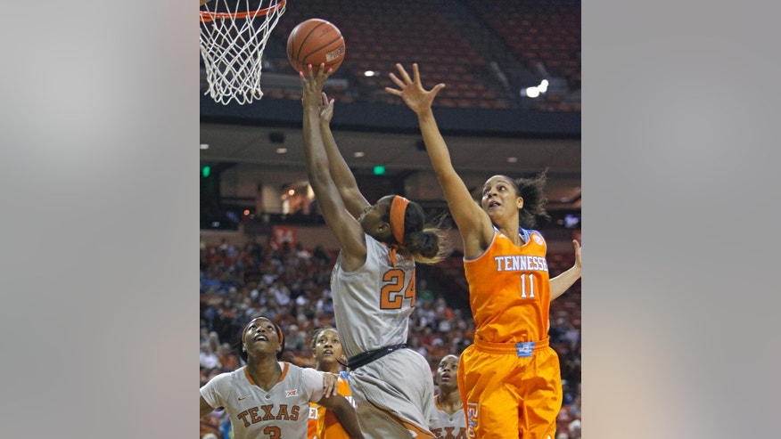 Texas guard Ariel Atkins (24) goes up to shoot against Tennessee  forward Cierra Burdick (11) during the first half of an NCAA college basketball game, Sunday, Nov. 30, 2014, in Austin, Texas. (AP Photo/Michael Thomas)
