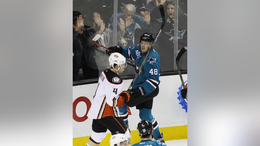 San Jose Sharks' Tomas Hertl (48) celebrates with fans after scoring a goal, as Anaheim Ducks' Brenden Dillon (4) skates by during the second period of an NHL hockey game, Saturday, Nov. 29, 2014, in San Jose, Calif. (AP Photo/George Nikitin)