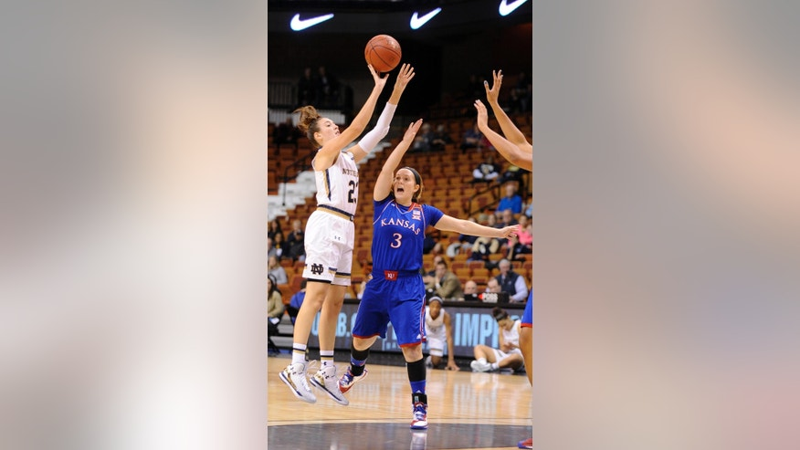 Notre Dame's Michaela Mabrey (23) shoots over Kansas' Lauren Aldridge (3) during the first half of an NCAA college basketball game in Uncasville, Conn., Sunday, Nov. 30, 2014. (AP Photo/Fred Beckham)