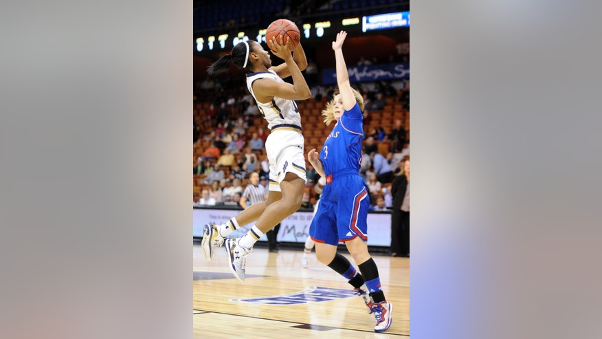 Notre Dame's Lindsay Allen, left, shoots over Kansas' Lauren Aldridge (3) during the first half of an NCAA college basketball game in Uncasville, Conn., Sunday, Nov. 30, 2014. (AP Photo/Fred Beckham)