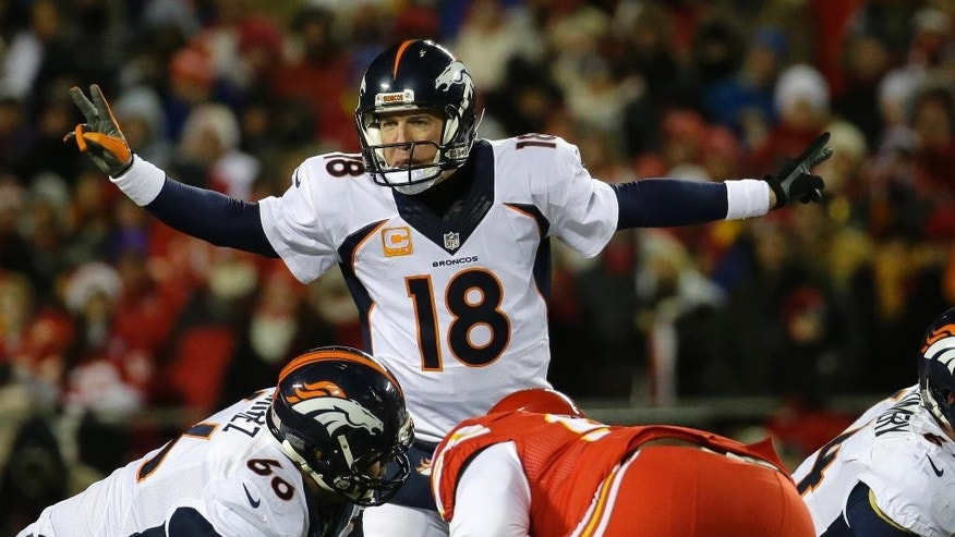 Denver Broncos quarterback Peyton Manning (18) calls a play in the first half of an NFL football game against the Kansas City Chiefs in Kansas City, Mo., Sunday, Nov. 30, 2014. (AP Photo/Charlie Riedel)