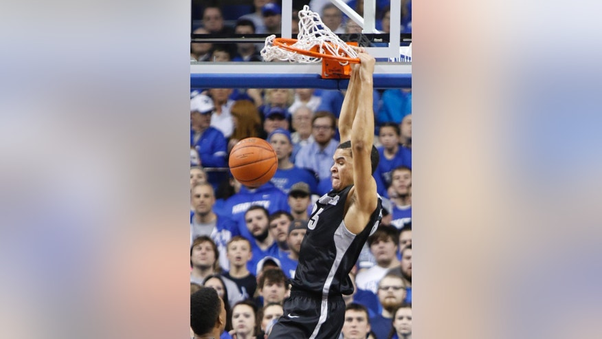 Providence's Tyler Harris dunks during the first half of an NCAA college basketball game against Kentucky, Sunday, Nov. 30, 2014, in Lexington, Ky. (AP Photo/James Crisp)