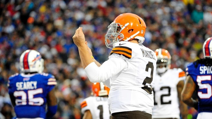 Cleveland Browns quarterback Johnny Manziel celebrates after scoring a touchdown against the Buffalo Bills during the second half of an NFL football game, Sunday, Nov. 30, 2014, in Orchard Park, N.Y. (AP Photo/Gary Wiepert)