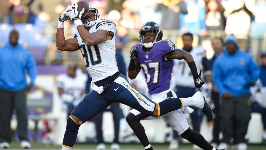 San Diego Chargers wide receiver Malcom Floyd, left, makes a catch in front of Baltimore Ravens defensive back Danny Gorrer in the second half of an NFL football game, Sunday, Nov. 30, 2014, in Baltimore. (AP Photo/Nick Wass)