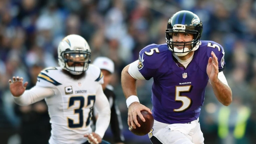 San Diego Chargers quarterback Philip Rivers, left, is sacked by Baltimore Ravens outside linebacker Terrell Suggs in the second half of an NFL football game, Sunday, Nov. 30, 2014, in Baltimore. (AP Photo/Alex Brandon)