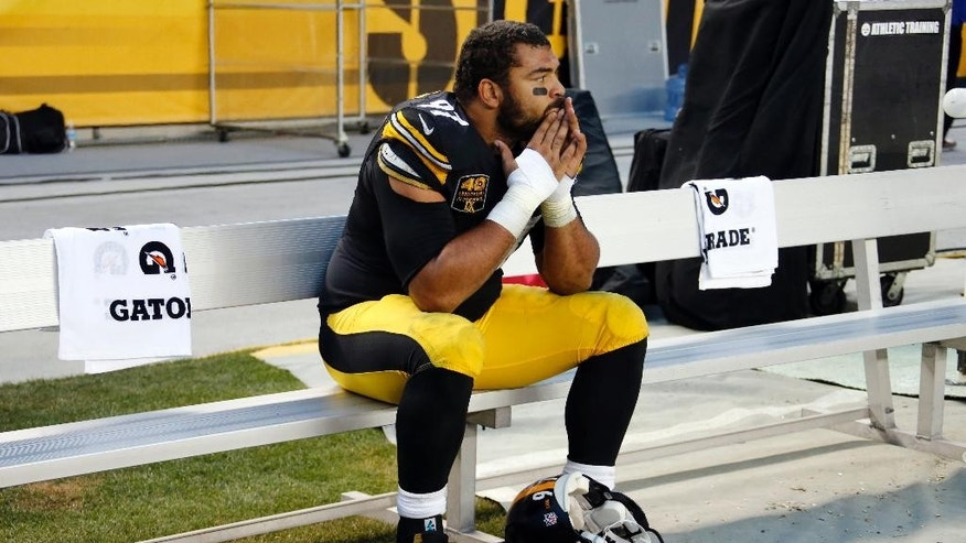 Pittsburgh Steelers defensive end Cameron Heyward (97) sits on the sideline during the second half of an NFL football game against the New Orleans Saints in Pittsburgh, Sunday, Nov. 30, 2014. The Saints won 35-32. (AP Photo/Gene J. Puskar)