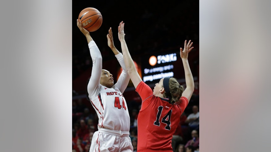 Rutgers' Betnijah Laney (44) shoots past Davidsons defender Mellissa Giegerich (14) during the first half of an NCAA college basketball game Sunday, Nov. 30, 2014, in Piscataway, N.J. (AP Photo/Mel Evans)