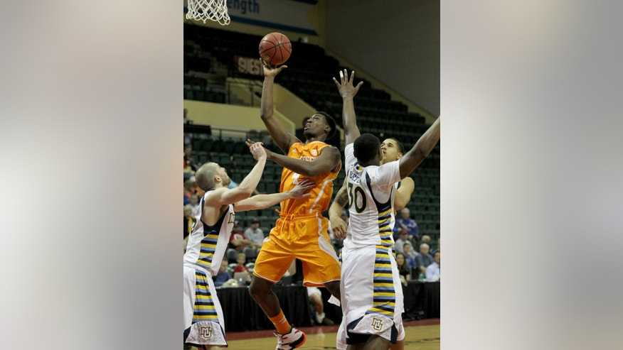 Tennessee forward Armani Moore (4) shoots over Marquette guard Matt Carlino, left, and guard Deonte Burton (30) during the first half of an NCAA college basketball game in Lake Buena Vista, Fla., Sunday, Nov. 30, 2014. (AP Photo/Reinhold Matay)