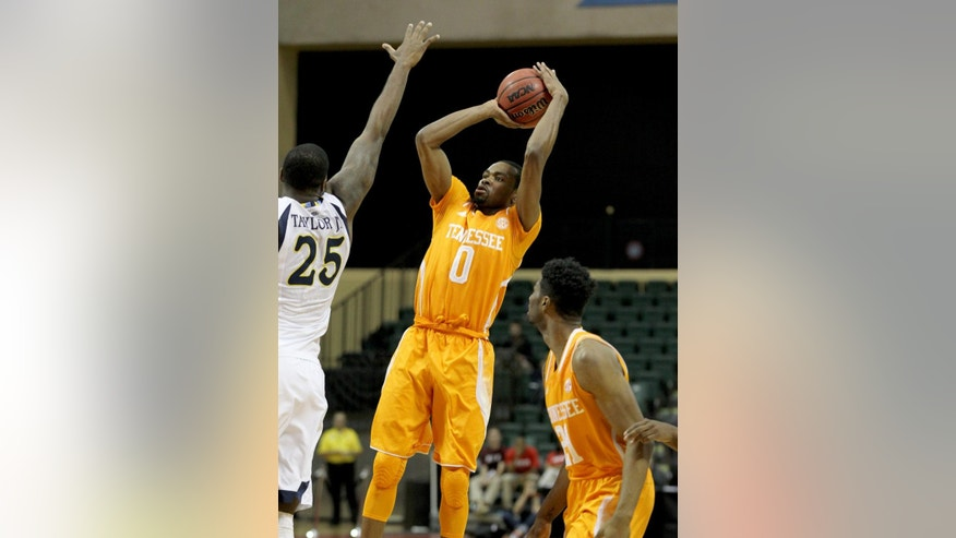 Marquette forward Steve Taylor Jr. (25) tries to block the shot of Tennessee guard Kevin Punter (0) as forward Jabari McGhee (21) looks on during the first half of an NCAA college basketball game in Lake Buena Vista, Fla., Sunday, Nov. 30, 2014. (AP Photo/Reinhold Matay)