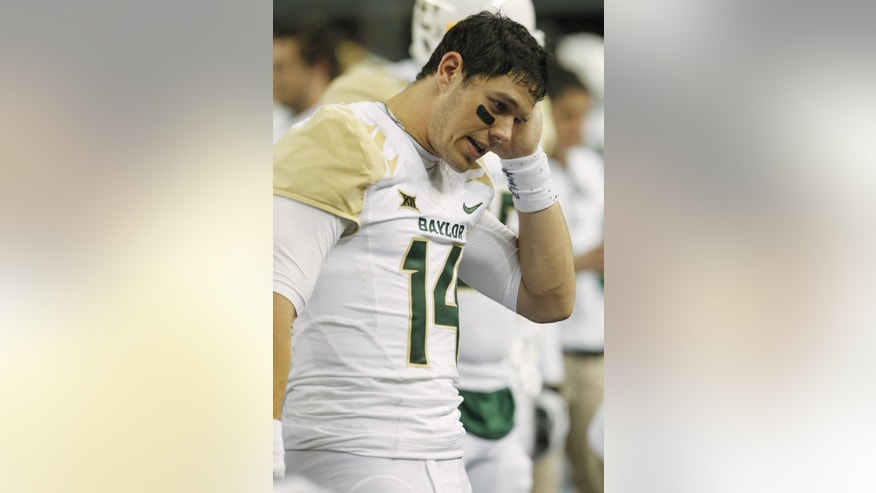 Baylor quarterback Bryce Petty (14) walks on the sidelines in the second half of an NCAA college football game against Texas Tech, Saturday, Nov. 29, 2014, in Arlington, Texas. Baylor won the game 48-46.  (AP Photo/Tim Sharp)