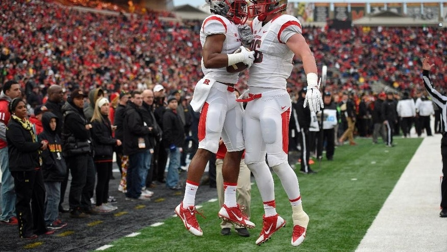 Rutgers wide receiver Leonte Carroo, left, celebrates his touchdown with Tyler Kroft, right, during the first half of an NCAA college football game against Maryland, Saturday, Nov. 29, 2014, in College Park, Md. Rutgers won 41-38.  (AP Photo/Nick Wass)