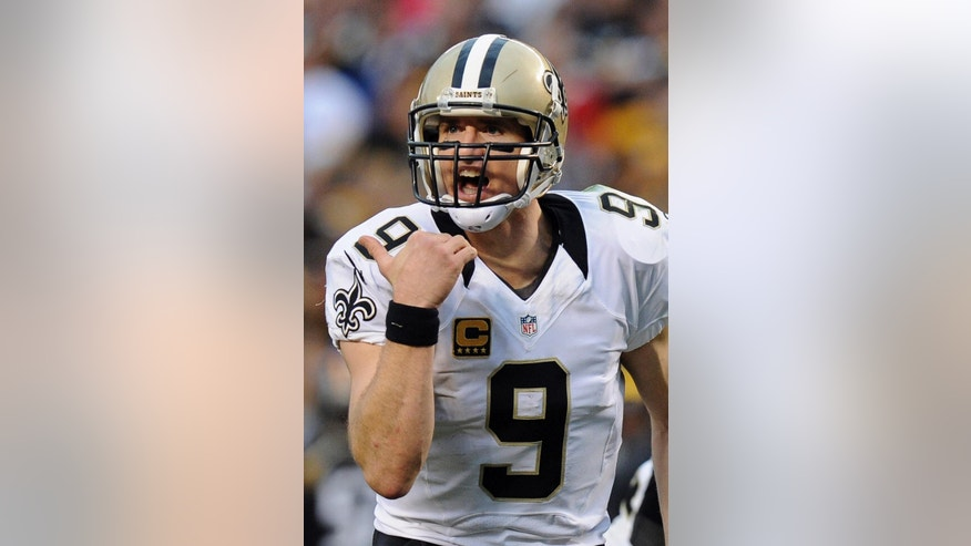 New Orleans Saints quarterback Drew Brees (9) directs his team in the fourth quarter of the NFL game against the Pittsburgh Steelers, Sunday, Nov. 30, 2014, in Pittsburgh. New Orleans won 35-32. (AP Photo/Don Wright)