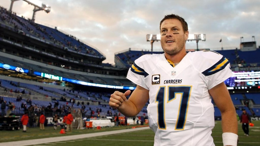 San Diego Chargers quarterback Philip Rivers acknowledges fans as he jogs off the field after an NFL football game against the Baltimore Ravens, Sunday, Nov. 30, 2014, in Baltimore. San Diego won 34-33. (AP Photo/Alex Brandon)