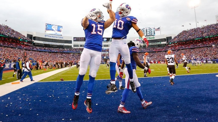 Buffalo Bills wide receiver Chris Hogan, left, and wide receiver Robert Woods celebrate Hogan's touchdown catch against the Cleveland Browns during the second half of an NFL football game, Sunday, Nov. 30, 2014, in Orchard Park, N.Y. (AP Photo/Bill Wippert)