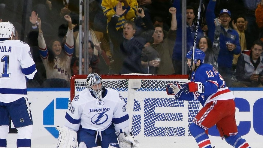 New York Rangers' Lee Stempniak (12) celebrates as Tampa Bay Lightning goalie Ben Bishop (30) reacts after allowing a goal by Kevin Hayes during the first period of an NHL hockey game Monday, Dec. 1, 2014, in New York. (AP Photo/Jason DeCrow)