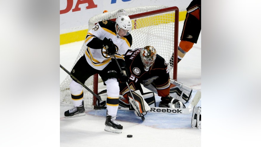 Anaheim Ducks goalie Frederik Andersen blocks a shot by Boston Bruins right wing Reilly Smith during the first period of an NHL hockey game in Anaheim, Calif., Monday, Dec. 1, 2014. (AP Photo/Chris Carlson)