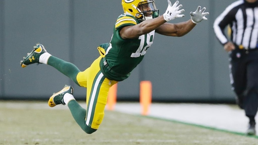 Green Bay Packers' Randall Cobb can't catch a pass during the first half of an NFL football game against the New England Patriots Sunday, Nov. 30, 2014, in Green Bay, Wis. (AP Photo/Tom Lynn)