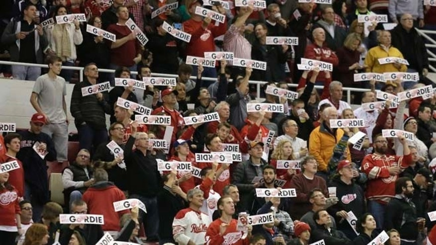 "Oct. 31, 2014: Fans wave ""Get Well Gordie"" signs for Detroit Red Wings legend Gordie Howe during the first period of an NHL hockey between the Detroit Red Wings and Los Angeles Kings, in Detroit."
