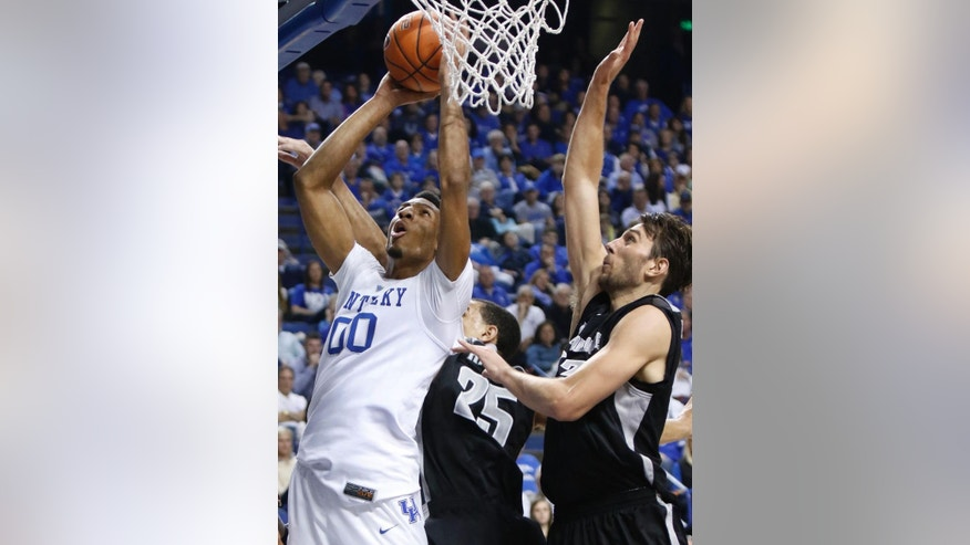Kentucky's Marcus Lee (00) shoots under pressure from Providence's Tyler Harris and Carson Desrosiers, right, during the first half of an NCAA college basketball game, Sunday, Nov. 30, 2014, in Lexington, Ky. (AP Photo/James Crisp)