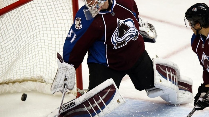 Colorado Avalanche goalie Calvin Pickard watches as a power-play goal slips into the net off stick of Montreal Canadiens defenseman Andrei Markov in the second period of an NHL hockey game in Denver on Monday, Dec. 1, 2014. (AP Photo/David Zalubowski)