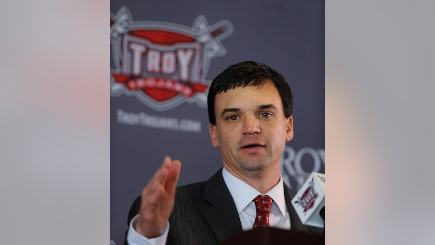 Neal Brown speaks after he is introduced as the new head NCAA college football coach at Troy University on Monday Dec. 1, 2014, in Troy, Ala.  (AP Photo/The Montgomery Advertiser, Mickey Welsh)  NO SALES