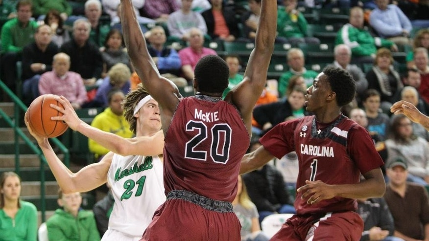 Marshall's Aleksa Nikolic (21) gets double-team pressed  by South Carolina's Justin McKie (20) and Marcus Stroman (1) during an NCAA college basketball game Monday, Dec. 1, 2014, at the Cam Henderson Center in Huntington, W.Va. (AP Photo/The Herald-Dispatch, Bishop Nash)