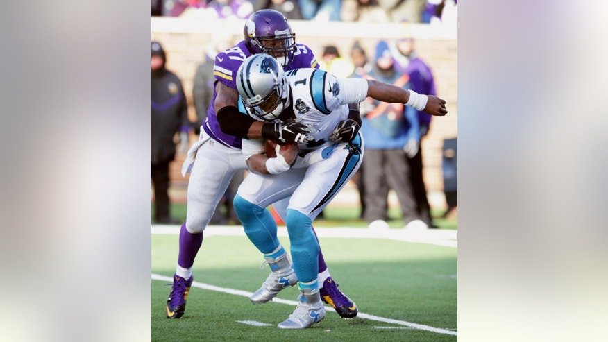 Minnesota Vikings defensive end Everson Griffen sacks Carolina Panthers quarterback Cam Newton (1) during the second half of an NFL football game, Sunday, Nov. 30, 2014, in Minneapolis. (AP Photo/Jim Mone)