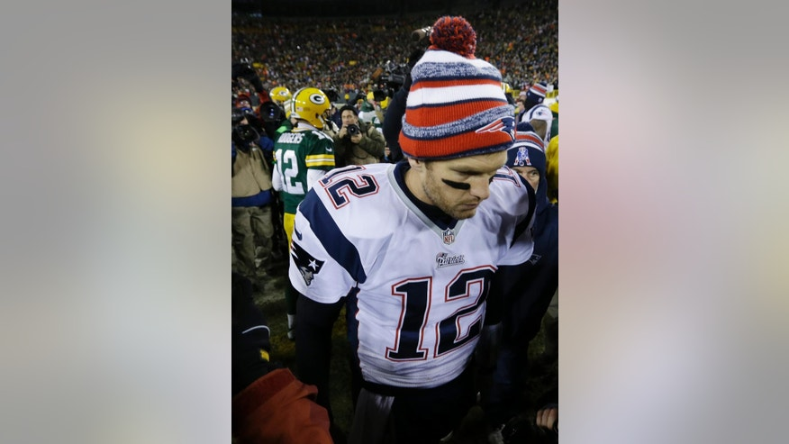New England Patriots' Tom Brady walks off the field after talking to Green Bay Packers' Aaron Rodgers after an NFL football game Sunday, Nov. 30, 2014, in Green Bay, Wis. The Packers won 26-21. (AP Photo/Morry Gash)