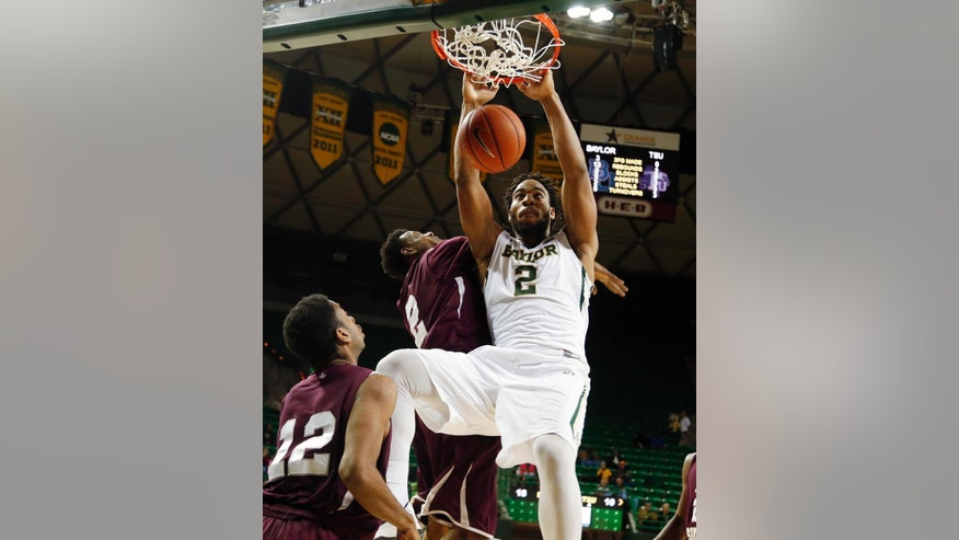 Baylor forward Rico Gathers (2) dunks over Texas Southern forward Tonnie Collier (12) and forward Chris Thomas (2) in the first half of an NCAA college basketball game, Monday, Dec. 1, 2014, in Waco, Texas. (AP Photo/The Waco Tribune-Herald, Rod Aydelotte)