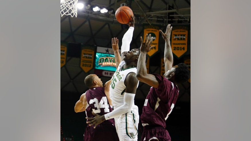 Baylor forward Johnathan Motley, center, attempts a shot near forward Chris Thomas, right, in the first half of an NCAA college basketball game, Monday, Dec. 1, 2014, in Waco, Texas. (AP Photo/The Waco Tribune-Herald, Rod Aydelotte)