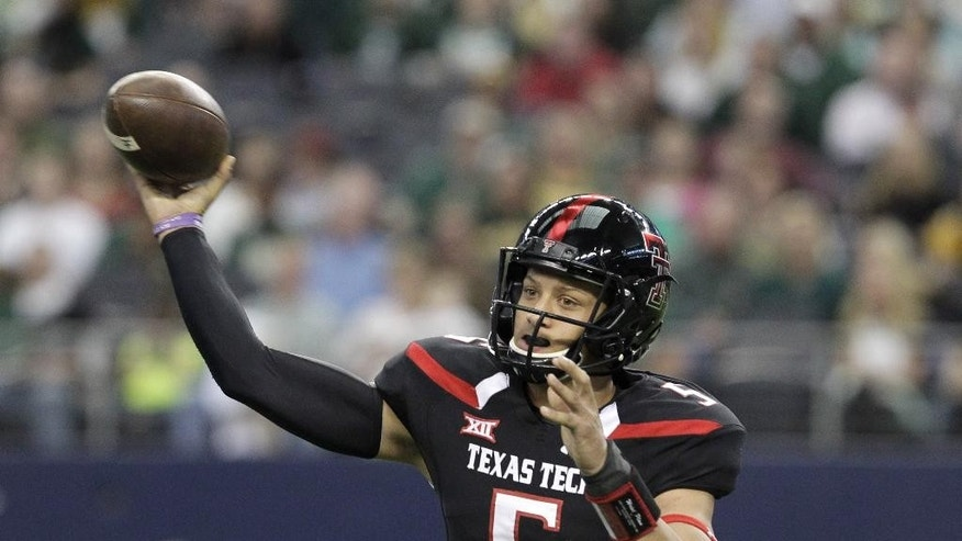 Texas Tech quarterback Patrick Mahomes (5) throws a pass against the Baylor in the first half of an NCAA college football game, Saturday, Nov. 29, 2014, in Arlington, Texas. (AP Photo/Tim Sharp)