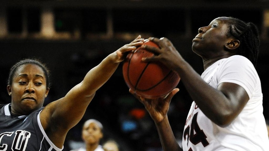 South Carolina forward Aleighsa Welch (24) goes for a shot as North Carolina Central guard Rachel Williams, left, defends during the first half of an NCAA college basketball game, Monday, Dec. 1, 2014, in Columbia, S.C. (AP Photo/Rainier Ehrhardt)
