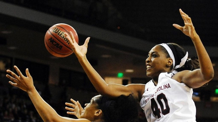 South Carolina forward Jatarie White (40) and North Carolina Central forward Nikki Works, left, go for a loose ball during the first half of an NCAA college basketball game, Monday, Dec. 1, 2014, in Columbia, S.C. (AP Photo/Rainier Ehrhardt)