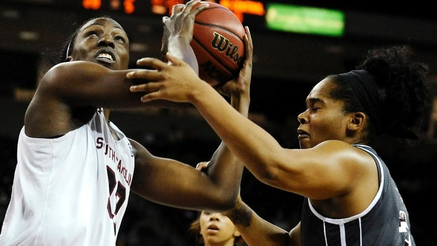 South Carolina center Elem Ibiam (33) goes for a shot as North Carolina Central forward Nikki Works (21) defends during the first half of an NCAA college basketball game, Monday, Dec. 1, 2014, in Columbia, S.C. (AP Photo/Rainier Ehrhardt)